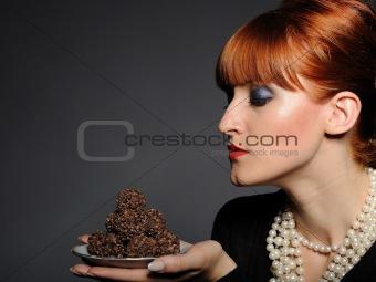 Beautiful elegant fashion woman with chocolate truffle sweets