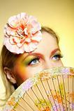 Close-up portrait of summer fashion creative eye make-up