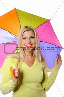 Portrait of pretty autumn woman standing under umbrella.