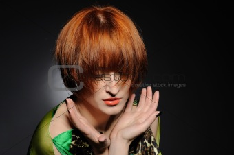 Beautiful red heaired woman portrait with fashion hairstyle