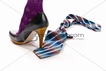 woman's shoe on high heel tread colorful tie