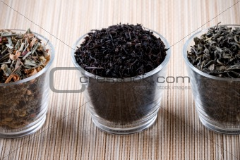 three kinds of dry tea in glasses
