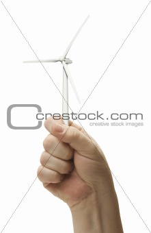 Male Fist Holding Wind Turbine Isolated on a White Background.