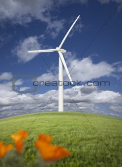 Wind Turbine Against Dramatic Sky, Clouds and California Poppies in the Foreground.