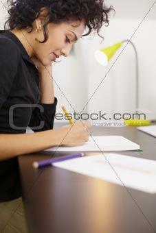 Woman working with sketches in fashion design studio
