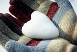 Snow heart in woman hands