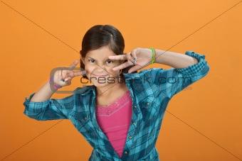 Little Girl making hand gesture