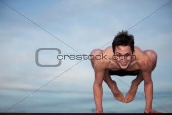 Happy Young Man Doing Yoga