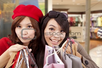 Two happy girls in a shopping center