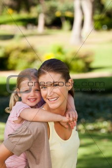 Beautiful mother giving daughter a piggyback