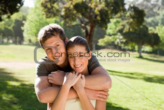 Man hugging his beautiful wife