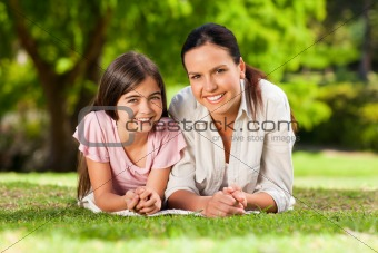 Mother with her daughter lying down