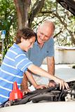 Father Teaches Son to Fix Car