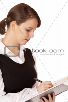 Business woman writes in notepad