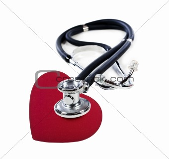a Doctor's stethoscope listening to a red heart