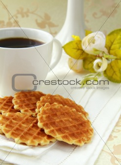 cup of black coffee and Belgian waffles for dessert
