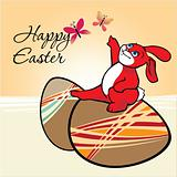 Easter Egg for Easter holiday celebration and a cute red bunny is playing with butterfly