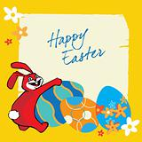 The rabbit and colourful Easter eggs on a yellow background