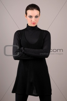 attractive woman standing on a gray background