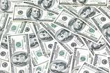 Business background with many american dollars