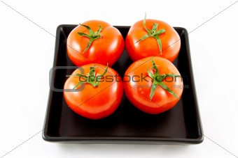 four tomatoes on a tray