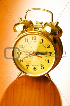 Alarm clock against wooden background