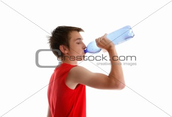 Boy teen drinking bottled water