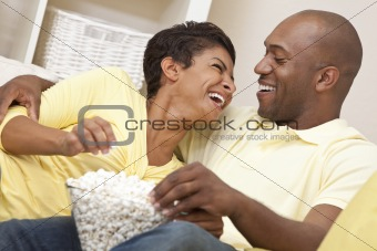 Happy African American Couple Eating Popcorn Watching Movie