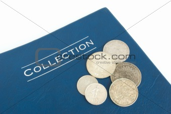old silver coins on an album