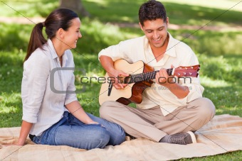Romantic man playing guitar fo