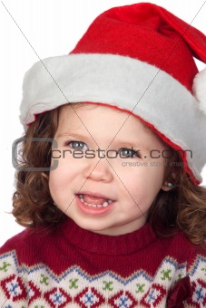Beautiful baby girl with Christmas cap