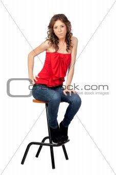 Beautiful girl sitting o a stool