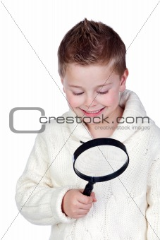 Adorable child with a magnifying glass