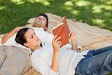 Couple reading in the park