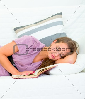 Attractive woman sleeping on sofa at livingroom