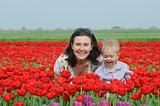 In Tulip Field. Mother with son in tulips field