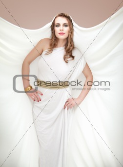 portrait of young woman in greek inspired white dress, smiling