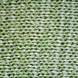 Green knitted textured background