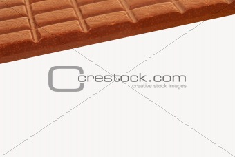 Stick of dark chocolate on a white background
