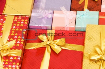 Close up of gift boxes with golden ribbons