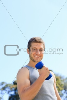 Young man doing his exercises in the park