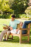 Man reading a book with his girlfriend