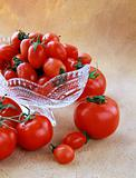 different varieties of tomatoes in a crystal vase