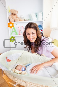 Attentive young mother taking care of her adorable baby