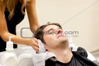 Positive caucasian man shampooed