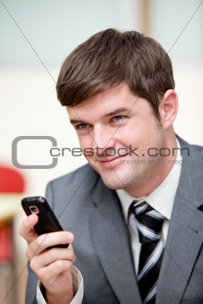 Portrait of an assertive businessman sending a text message with