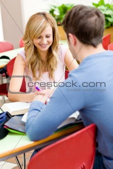 Cute couple of students working together