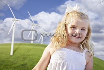 Beautiful Young Girl Playing in Wind Turbine Field