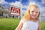 Cute Smiling Girl in Yard with For Sale Real Estate Sign and House