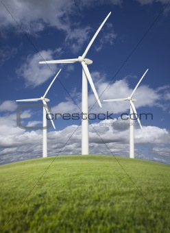 Three Wind Turbines Over Grass Field, Dramatic Sky and Clouds.